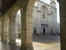 Cathedral of Merida. View of the Cathedral of Merida from the the arcade of the Government Palace royalty free stock photos