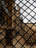CATHEDRAL THROUGH THE FENCE, SEVILLE, SPAIN Stock Photo