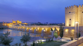 Cathedral Mezquita and Roman bridge at sunset Royalty Free Stock Image