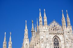 Cathedral in Milan, Duomo. The famous Duomo, cathedral church of Milan, Italy. Details of spires with the Madonnina statue of the Virgin Mary Stock Photos