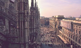 Cathedral of Milan and street. Ornate architecture of the Cathedral of Milan, Italy, with a nearby street and buildings. Color modified stock images