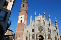 Cathedral, Monza. Gothic cathedral facade and bell tower on blue sky, Monza, Lombardy, Italy Stock Image