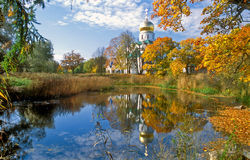 Cathedral Near The Pond In Autumn Royalty Free Stock Images