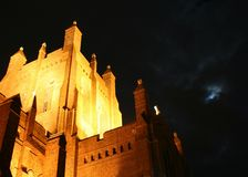 Cathedral at Night. Newcastle Christchurch Cathedral with cloud covered moon Stock Photo