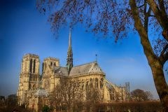 Facade of Notre Dame cathedral in Paris next to the Seine River. Stock Image
