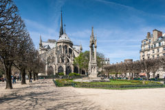 Cathedral of Notre Dame de Paris against the blue clear sky. Stock Images