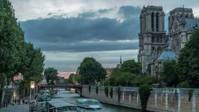 Cathedral Notre Dame de Paris day to night timelapse after sunset in Paris, France. Cathedral Notre Dame de Paris day to night transition timelapse after sunset stock video footage