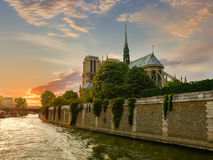 Cathedral Notre-Dame de Paris in springtime at sunset. View from the river Seine of the Cathedral Notre-Dame de Paris from the southeast in the rays of the Stock Photo