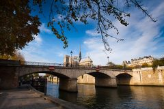 Cathedral of Notre Dame de Paris sunny autumn afternoon. Seine riverside Royalty Free Stock Photo
