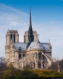 Cathedral of Notre Dame de Paris sunny autumn afternoon. Seine riverside Royalty Free Stock Images