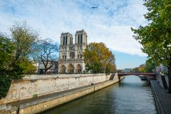 Cathedral of Notre Dame de Paris sunny autumn afternoon. Seine riverside. the most famous symbols of Paris Stock Photography