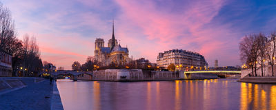 Cathedral of Notre Dame de Paris at sunset, France. Picturesque grandiose sunset over Cathedral of Notre Dame de Paris, France. Panorama Stock Image