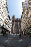 Cathedral Notre-Dame-de-Strasbourg with tourists on street Stock Images