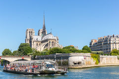 Cathedral Notre Dame Paris with cruise Stock Images