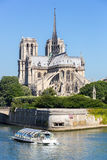 Cathedral Notre Dame Paris with cruise Stock Photography