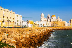 Cathedral and  ocean coast in Cadiz. Andalusia, Spain Royalty Free Stock Photo