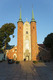 Cathedral Oliwa. Cathedral of Oilwa in the rays of the setting sun, Poland Stock Photo