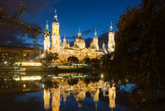 Cathedral of Our Lady of the Pillar in evening. Zaragoza Stock Photo