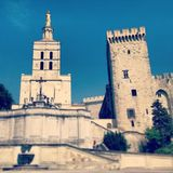 Cathedral and palace. The papal palace and cathedral in Avignon, France. Selective blur effect stock images