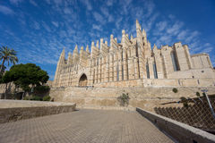 Cathedral of Palma de Majorca, wide angle. Wide angle view of Cathedral of Palma de Majorca with blue sky and clouds Stock Image