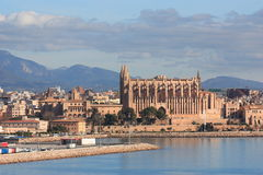 Cathedral in Palma de Mallorca. The image of the cathedral in Palma de Maccorca in Spain against blue sky and mountains Stock Images