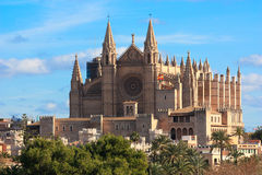 Cathedral in Palma de Mallorca. The image of the cathedral in Palma de Maccorca in Spain against blue sky and mountains Royalty Free Stock Photography