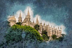 Cathedral of Palma de Mallorca. Cathedral of Palma de Mallorca viewed through lush greenery of the island. Big gothic church beside palm trees under the blue Stock Photography