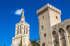 Cathedral and Papal palace in Avignon. Christian cross in front of Cathedral and Papal palace in Avignon in a beautiful summer day, France stock photography