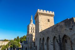 Cathedral and Papal palace in Avignon. Christian cross in front of Cathedral and Papal palace in Avignon in a beautiful summer day, France stock images