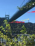 Cathedral Park Shell Protesters Hang from St. Johns Bridge. Oil drilling protestors hang from St. Johns Bridge in Portland, Oregon's Cathedral Stock Photo