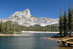 Cathedral Peak and Cathedral Lake on a Sunny Day. Royalty Free Stock Images