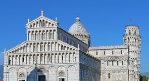 The Cathedral of Pisa Duomo di Pisa with the Leaning Tower of Pisa Torre di Pisa in Piazza dei Miracoli. stock image