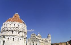 Cathedral of Pisa in Italy. Pizza del Duomo featuring the Battistero di San Giovanni, Leaning Tower, and Cathedral di Pisa Stock Photography