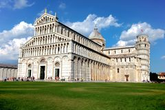 The Cathedral of Pisa and the Pisa Tower in Pisa, Italy. The leaning tower of Pisa is one of the most famous tourist destinations. In the world which is located stock photography