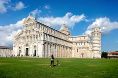 The Cathedral of Pisa and the Pisa Tower in Pisa, Italy. The leaning tower of Pisa is one of the most famous tourist destinations. In the world which is located royalty free stock image