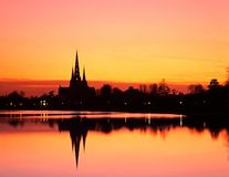 Cathedral and pool at sunset, Lichfield, England. Royalty Free Stock Photos