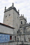 Cathedral, Porto, Portugal. Stone wall and turrets of The Cathedral in Porto, Portugal against cloudy blue skies Stock Photography