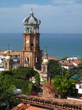 Cathedral in Puerto Vallarta, Mexico. View of the cathedral in Puerto Vallarta, Mexico with the Pacific Ocean beyond Royalty Free Stock Image