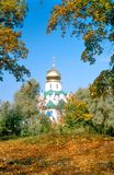 Cathedral and red autumn leaves Stock Images