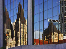 Cathedral Reflections. Reflections of St Johns Cathedral Brisbane in windows of modern highrise building Stock Image