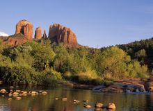 Cathedral Rock  2. Iconic Cathedral Rock and Red Rock Crossing  in Sedona, AZ.  Most photographed site in Arizona.  Red rock, green foliage and clear blue skies Stock Photos