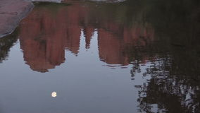 Cathedral Rock and Moon Reflection Stock Image