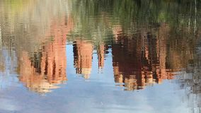 Cathedral Rock Reflections Loop - Sedona, Arizona. Seamless loop features the pinnacles of Sedona, Arizona`s Cathedral Rock are reflected in the waters of Oak stock video