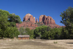 Cathedral Rock, Sedona Arizona. A scenic view of cathedral rock near sedona arizona with meadow and cabin in the foreground Royalty Free Stock Image
