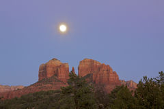 Cathedral Rock, Sedona Arizona and Moon. A dramatic scenic view of cathedral rock near sedona arizona at sunset with the full moon rising Stock Photos