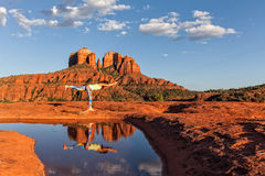 Cathedral Rock Sedona Arizona Yoga Practice. A woman practicing yoga in a scenic landscape and reflection of iconic cathedral rock near sedona arizona royalty free stock image