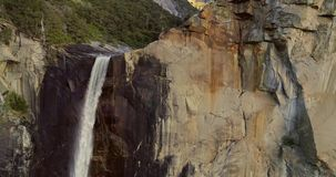 Cathedral Rocks. 4K. November 2017. Drone. Waterfall. Sunrise. Sunset. Cathedral Rocks. Flight over the Waterfall. Sequoia National Park. The first video of the stock footage