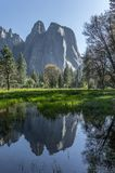 Cathedral Rocks reflected in the lake at Yosemite National Park stock image