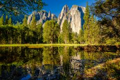 Cathedral Rocks reflecting in Merced River at Yosemite Royalty Free Stock Images