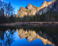 Cathedral Rocks Reflections. Cathedral Rocks and Bridalveil Falls reflecting in the Merced River at sunset in Yosemite National Park, California Stock Image